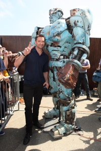 Hugh Jackman at Comic Con with Robot from Real Steel