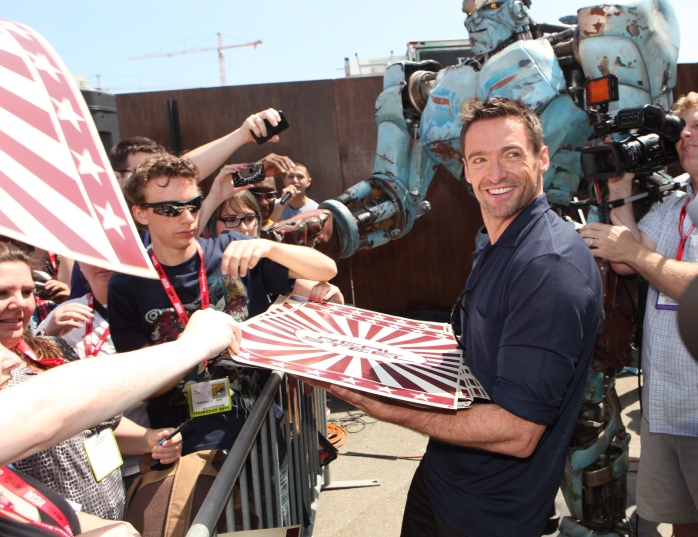 Hugh Jackman at Comic Con for Real Steel passing out film posters
