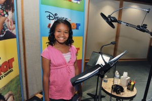 """Kiara Muhammad records the title role of Doc in Disney Junior's """"Doc McStuffins,"""" an animated series that models good health, hygiene, compassion and nurturing for kids age 2-7. The series premieres FRIDAY, MARCH 23 on the popular Disney Junior block on Disney Channel (10:00-11:00 a.m., ET/PT) and the new 24-hour Disney Junior channel (4:00-5:00 p.m., ET/PT). (DISNEY JUNIOR/TODD WAWRYCHUK)"""